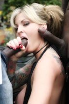 Janine Lindemulder receives a stream of sperm in the face.